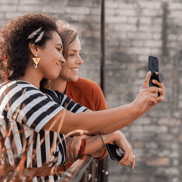 Two women taking a selfy on a new phone